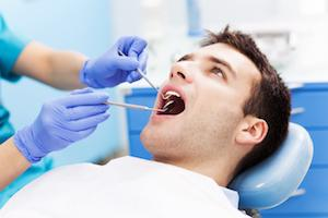 man getting dental exam in dental exam chair I oral surgery in apex nc