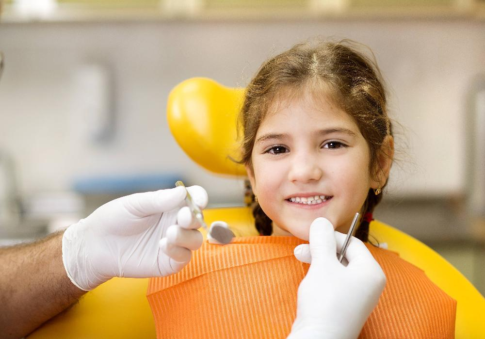 Young girl smiling during treatment with childrens dentist in Apex NC